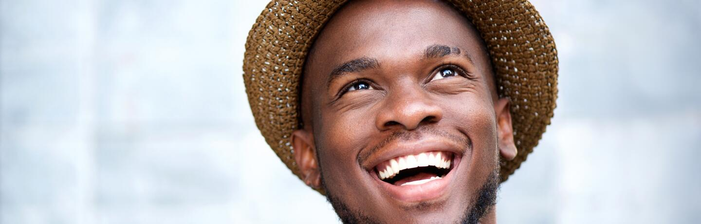 OC_YOUNG_MAN_HAT_SMILE_SHUTTERSTOCK_253202191