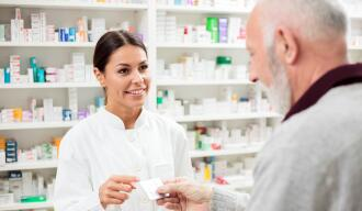 OG_PHARMACIST_WOMAN_GIVING_MEDICINES_PILLS_OLD_MAN_PATIENT_ISTOCK_2021