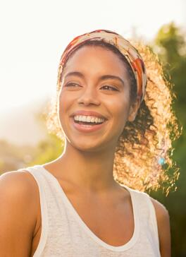 OC_YOUNG_WOMAN_SMILE_SUN_SHUTTERSTOCK_1123160147