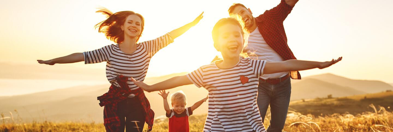 OC_FAMILY_HAPPY_NATURE_SUN_SHUTTERSTOCK_1350510212