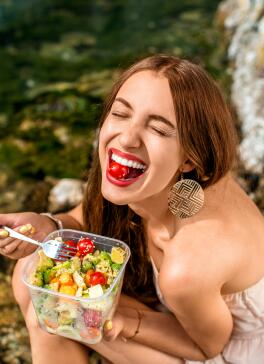 OC_YOUNG_GIRL_EATING_SMILING_HEALTHY_SHUTTERSTOCK_291921743