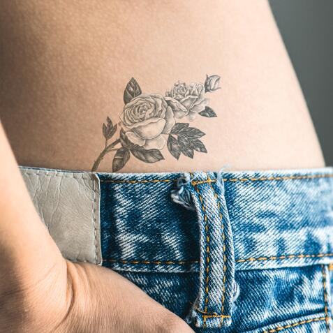 AD_TATTOOS_WOMAN-HIP-FLOWERS_LARGE